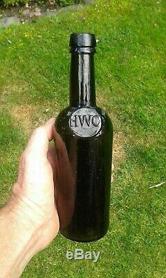 A Lovely Split Size Sealed HWC Black Glass Wine Bottle