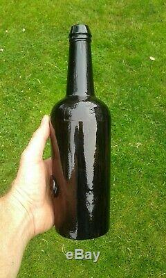 A Stunning Sealed T. C. C. R Trinity College Black Glass Bottle C1830