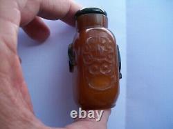 Chinese Qing Peking Glass Amber Snuff Bottle Dragon Flower Praying Figure Motif