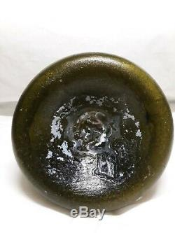 Early 18th Century Black Glass Onion Bottle Found In South Carolina Waters