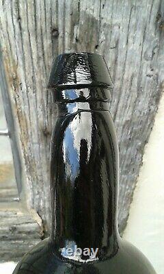 Early Black Glass Blown Sealed T C Wine Bottle