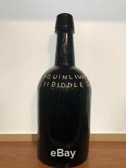 Ed. Quinlivan Black Glass Ale Bottle