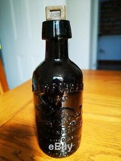 Newcastle Edinburgh Pictorial Black Glass Ginger Beer Bottle