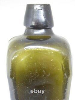Old black glass bottle blown 18th