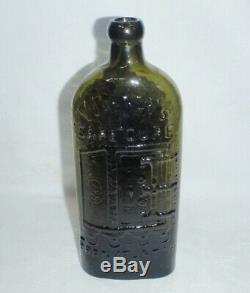 RAR. Warner's Safe Cure Frankfurt A/M Oliv / Black Glass. Original label